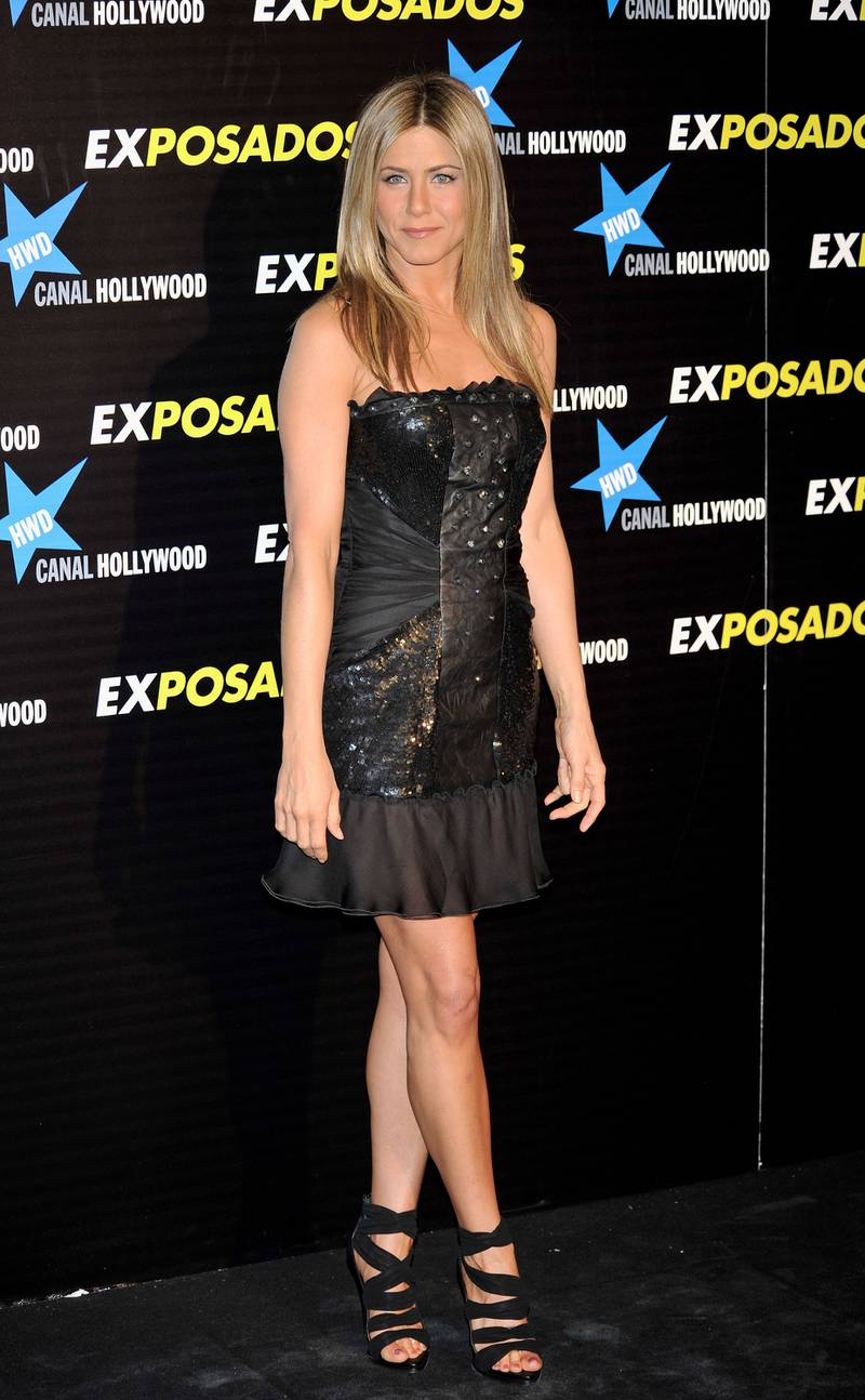 """MADRID, SPAIN - MARCH 30:  Actress Jennifer Aniston attends """"Exposados"""" (The Bounty Hunter) premiere at the Callao cinema on March 30, 2010 in Madrid, Spain.  (Photo by Carlos Alvarez/Getty Images)"""