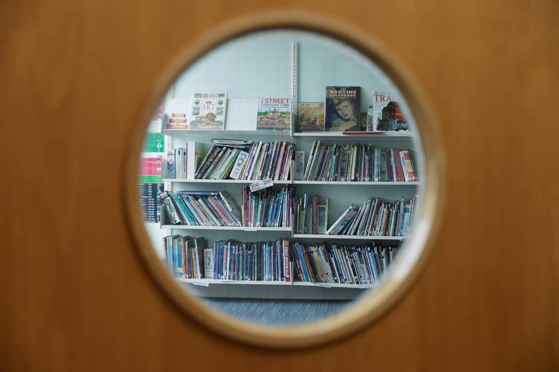 Books are seen through the window of the closed library as staff make preparations for Watlington Primary School to reopen to children on June 1, following the outbreak of the coronavirus disease (COVID-19), Watlington, Britain, May 21, 2020. REUTERS/Eddie Keogh