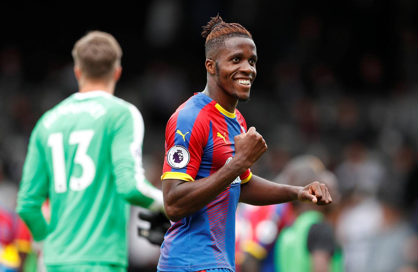 """Soccer Football - Premier League - Fulham v Crystal Palace - Craven Cottage, London, Britain - August 11, 2018   Crystal Palace's Wilfried Zaha celebrates after the match   Action Images via Reuters/John Sibley    EDITORIAL USE ONLY. No use with unauthorized audio, video, data, fixture lists, club/league logos or """"live"""" services. Online in-match use limited to 75 images, no video emulation. No use in betting, games or single club/league/player publications.  Please contact your account representative for further details."""