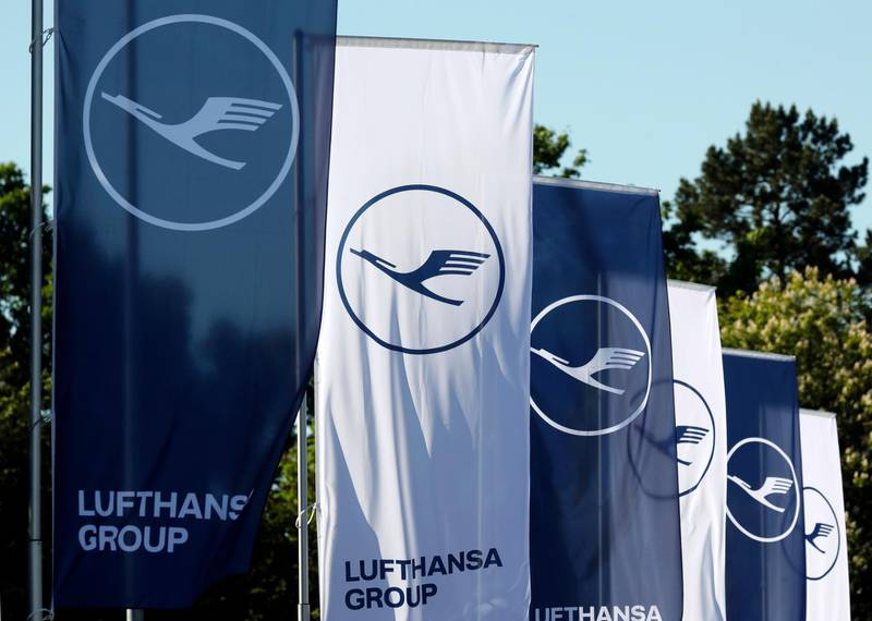epa06718473 Flags of Lufthansa AG fly prior the annual general meeting (AGM) of the Lufthansa Group in Frankfurt, Germany, 08 May 2018.  EPA/RONALD WITTEK