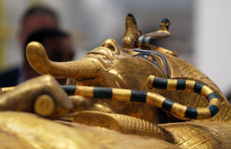 The mask                    of ancient Egypt's boy-king Tutankhamun is seen on the                    lid of his coffin as it undergoes restoration at the                    Grand Egyptian Museum in Giza, Egypt September 21,                    2019. REUTERS/Mohamed Abd El Ghany