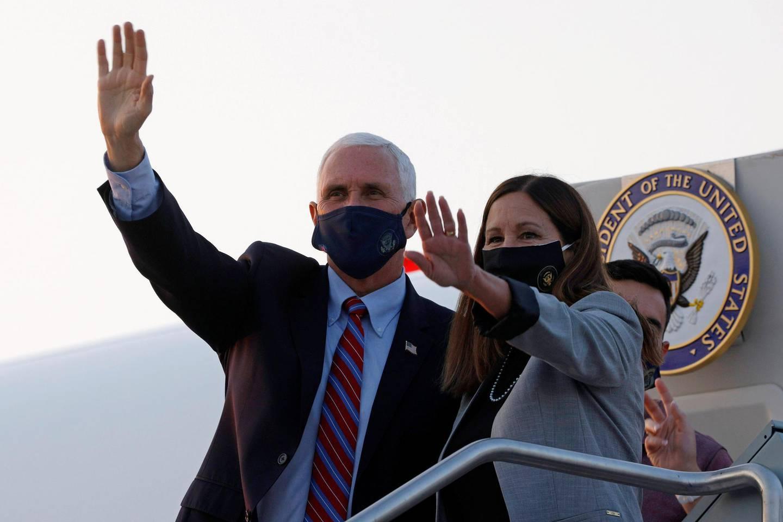 U.S. Vice President Mike Pence and his wife Karen arrive ahead of the vice presidential debate in Salt Lake City, Utah, U.S., October 5, 2020.   REUTERS/Brian Snyder