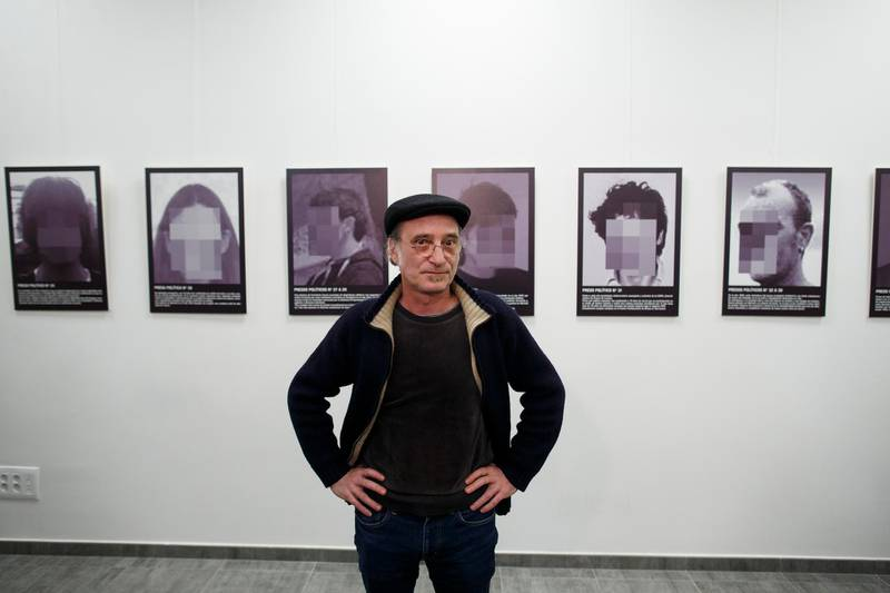 MADRID, SPAIN - FEBRUARY 26:  Spanish artist Santiago Sierra poses for press as he presents a reproduction of his work 'Political prisoners of contemporary Spain' at Anselmo Lorenzo Libertarian Studies Foundation after it was removed from ARCO art fair last week on February 26, 2018 in Madrid, Spain. Last week IFEMA decided to remove Sierra's art-installation from a major contemporary art fair. His work depicts two jailed Catalan separatist leaders, among others allegedly political prisoners in Spain. The row comes in the same week that a rapper was sentenced to three and half years in prison for his lyrics and a judge ordered copies of 'Farina', a book about drug smuggling in Galicia to be seized, during a defamation suit brought by a former mayor in the region.  (Photo by Pablo Blazquez Dominguez/Getty Images)