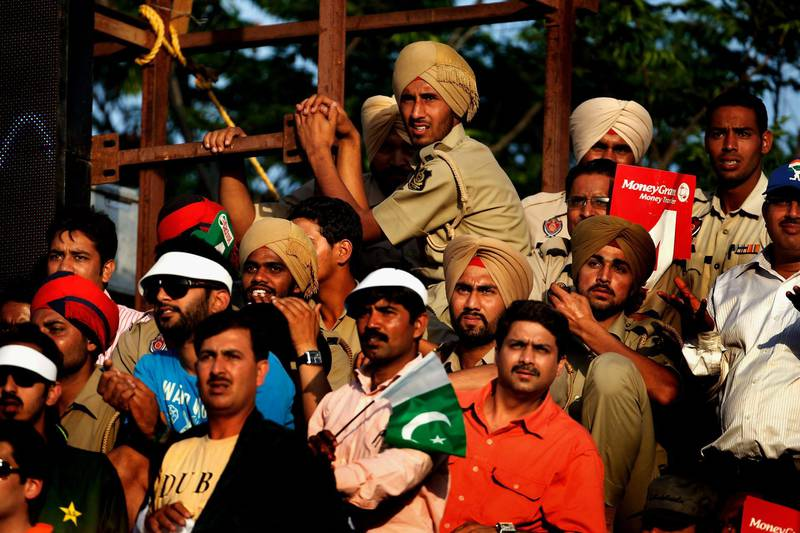 MOHALI, INDIA - MARCH 30:  Spectators enjoy the atmosphere during the 2011 ICC World Cup second Semi-Final between India and Pakistan at Punjab Cricket Association (PCA) Stadium on March 30, 2011 in Mohali, India.  (Photo by Daniel Berehulak/Getty Images)