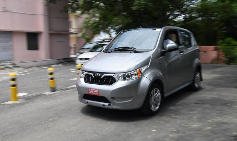 """This photo taken on July 21, 2017 shows Mahindra's electric car """"e2o Plus"""" in New Delhi. India will roll out nearly 100,000 battery-powered buses and autorickshaws onto its sulpherous, clogged city streets in coming weeks to set it on the road to make new vehicle sales all-electric by 2030. India, one of the world's most polluted nations, has one of the most ambitious plans to kick its fossil fuel addiction. Analysts say the target is """"daunting"""".  / AFP PHOTO / Prakash SINGH / TO GO WITH: India-automobile-pollution-technology, FOCUS by Megha BAHREE"""