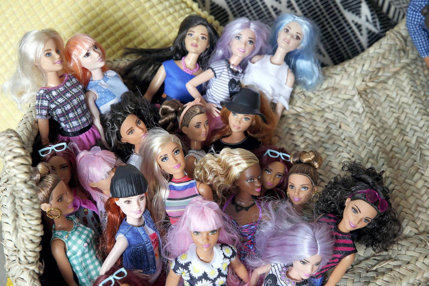 """PARIS, FRANCE - OCTOBER 20:  Barbie dolls from the 2017 """"Barbie Fashionistas"""" collection are displayed during an exhibition at Hotel Le Moliere on October 20, 2017 in Paris, France. Barbie expands its range of Fashionistas dolls with 15 new Ken dolls and 24 new Barbie dolls. The exhibition takes place on October 21 and 22, 2017.  (Photo by Chesnot/Getty Images)"""
