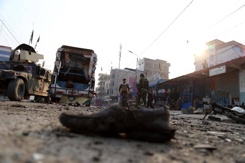 epa06365052 Afghan security officials inspect the scene of a suicide bomb blast in Jalalabad, Afghanistan, 03 December 2017. At least six people were killed and thirteen were injured in the incident. Since the end of NATO combat mission in January 2015, Kabul has been losing ground to insurgents and now controls only 57 percent of the country, according to the US.  EPA/GHULAMULLAH HABIBI