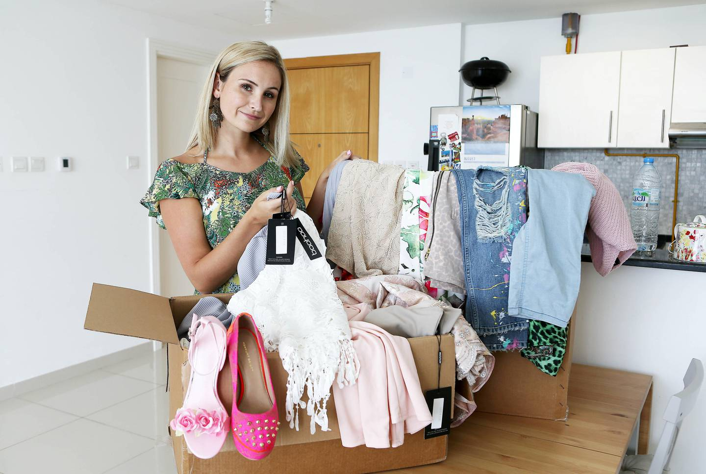 ABU DHABI , UNITED ARAB EMIRATES , AUG 11 – 2017 :- Jessica Smit with some of her clothes at her apartment in Marina Bay on Reem Island in Abu Dhabi. She is on mission not to buy any clothes for the whole of 2017. ( Pawan Singh / The National ) Story by Jessica Hill