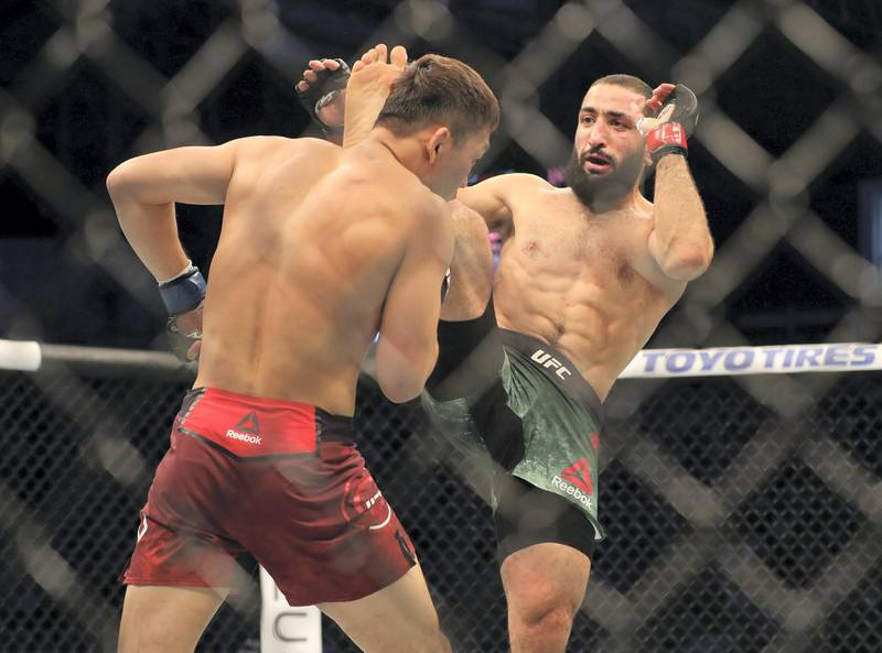 Abu Dhabi, United Arab Emirates - September 07, 2019: Welterweight bout between Belal Muhammad (green shorts, winner) and Takashi Satō in the Early Prelims at UFC 242. Saturday the 7th of September 2019. Yas Island, Abu Dhabi. Chris Whiteoak / The National