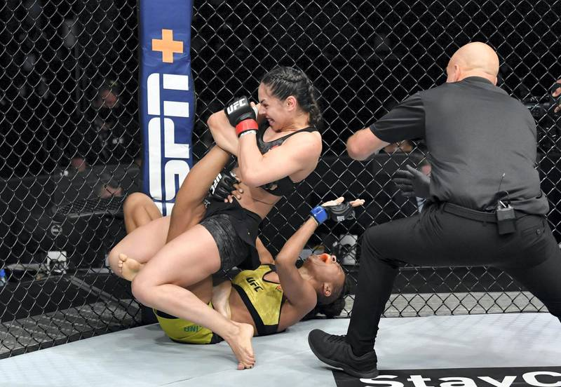 ABU DHABI, UNITED ARAB EMIRATES - JULY 19: (R-L) Ariane Lipski of Brazil secures a knee bar submission against Luana Carolina of Brazil in their flyweight bout during the UFC Fight Night event inside Flash Forum on UFC Fight Island on July 19, 2020 in Yas Island, Abu Dhabi, United Arab Emirates. (Photo by Jeff Bottari/Zuffa LLC via Getty Images)