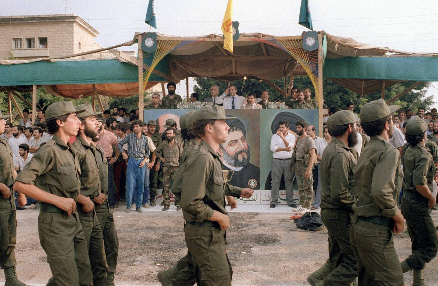 Nabih Berri (C-saluting), reviews militiamen from his Amal movement as they parade, 08 August 1986 in front of Imam Moussa Al Sadr portrait in the southern suburb of west Beirut. Berri, led the Amal movement, the first political organization of Lebanon's Shi'ite Moslems, during the fierce fighting of Lebanon's civil war. Berri was a key player in the negotiated release of the hostages following the hijacking of TWA Flight 847 in Beirut. He was elected Speaker of the Lebanese parliament 20 November 1992.  AFP PHOTO ASSAD JRADI / AFP PHOTO / ASSAD JRADI