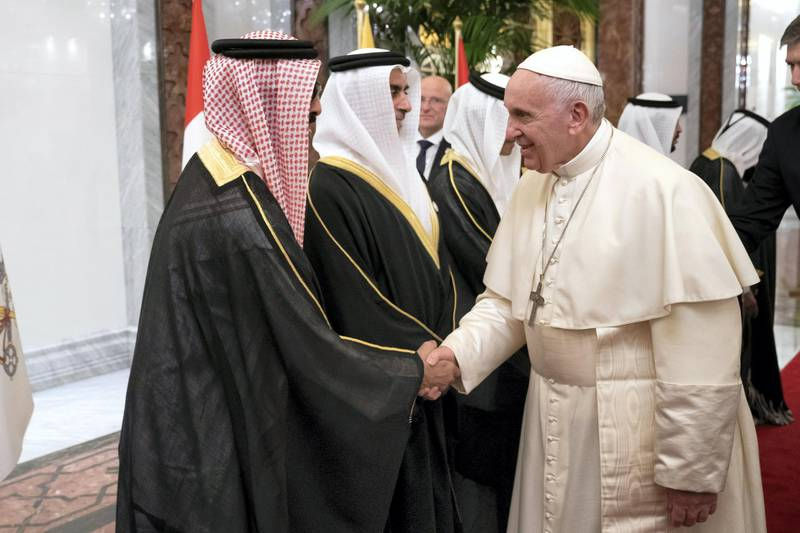 ABU DHABI, UNITED ARAB EMIRATES - February 3, 2019: Day one of the UAE Papal visit - HH Sheikh Tahnoon bin Zayed Al Nahyan, UAE National Security Advisor (L)  greets His Holiness Pope Francis, Head of the Catholic Church (R), at the Presidential Airport.  ( Ryan Carter / Ministry of Presidential Affairs ) ---