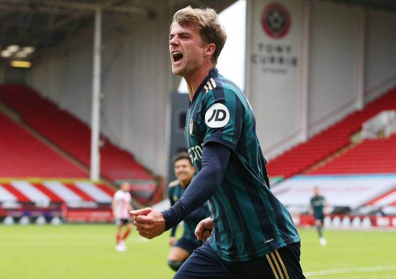 epa08701230 Patrick Bamford of Leeds celebrates scoring his team's opening goal during the English Premier League soccer match between Sheffield United and Leeds United in Sheffield, Britain, 27 September 2020.  EPA/Alex Livesey / POOL EDITORIAL USE ONLY. No use with unauthorized audio, video, data, fixture lists, club/league logos or 'live' services. Online in-match use limited to 120 images, no video emulation. No use in betting, games or single club/league/player publications.