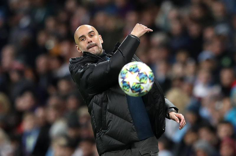 MANCHESTER, ENGLAND - OCTOBER 01: Pep Guardiola, Manager of Manchester City throws the ball during the UEFA Champions League group C match between Manchester City and Dinamo Zagreb at Etihad Stadium on October 01, 2019 in Manchester, United Kingdom. (Photo by Alex Pantling/Getty Images)