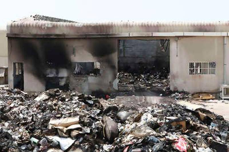 Dubai, 11th August 2010.  The aftermath of yesterday's fire at Afnan Perfumes Factory LLC, in Al Qouz Industrial Area 4.  (Jeffrey E Biteng / The National)