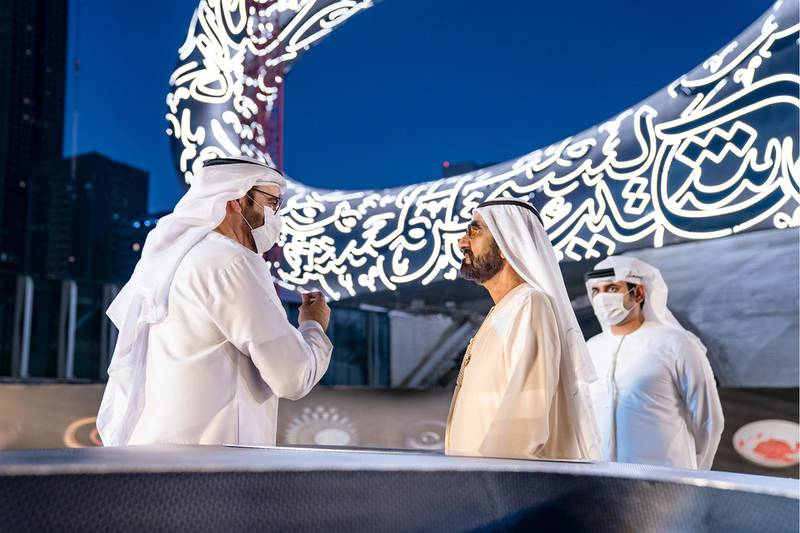 Sheikh Mohammed Bin Rashid, Vice-President and Prime Minister of the UAE and Ruler of Dubai, witnesses the installation of the final piece of façade of Museum of the Future. Seen with Sheikh Hamdan bin Mohammed bin Rashid Al Maktoum, Dubai Crown Prince and Chairman of The Executive Council of Dubai and Chairman of the Board of Trustees of Dubai Future Foundation; and Sheikh Maktoum bin Mohammed bin Rashid Al Maktoum, Deputy Ruler of Dubai. Seen with Mohammad bin Abdullah Al Gergawi, Cabinet Member, Minister of Cabinet Affairs, and Vice Chairman of the Board of Trustees of Dubai Future Foundation and Sheikh Maktoum bin Mohammed bin Rashid Al Maktoum, Deputy Ruler of Dubai. Courtesy Museum of the Future