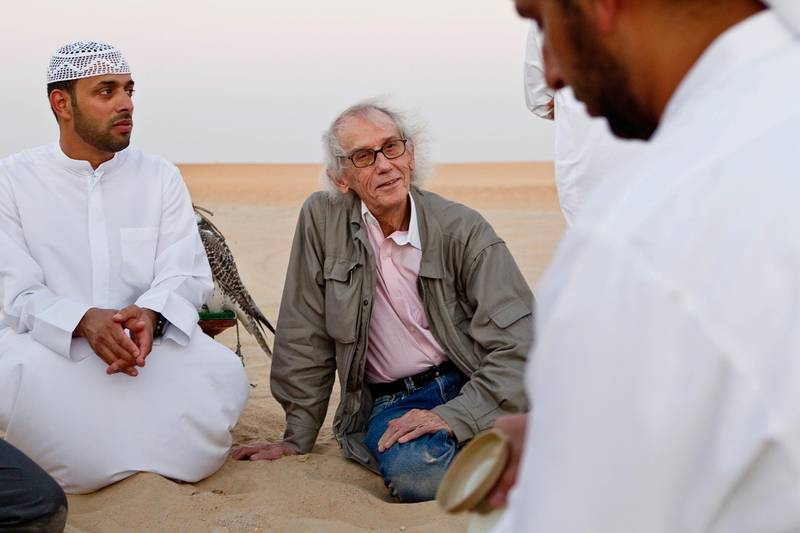 MADINAT ZAYED, UNITED ARAB EMIRATES,  October 10, 2012. Christo Yavacheff (center), a Bulgarian born instalation artistsnow living in New York, meets with Liwa residents Khalfan Al Qubasi (L) to discuss his plans to construct in Liwa a pyramid of 415,000 oil drums that will be bigger than the main pyramid of giza. (ANTONIE ROBERTSON / The National)