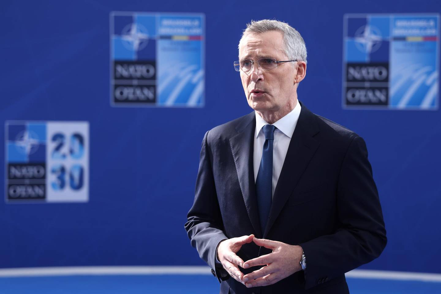 epa09269382 NATO Secretary General Jens Stoltenberg speaks to the press prior to a NATO summit at the North Atlantic Treaty Organization (NATO) headquarters in Brussels, Belfium, 14 June 2021. The allies meet to agree a statement stressing common ground on securing their withdrawal from Afghanistan, joint responses to cyber attacks and relations with a rising China.  EPA/KENZO TRIBOUILLARD / POOL