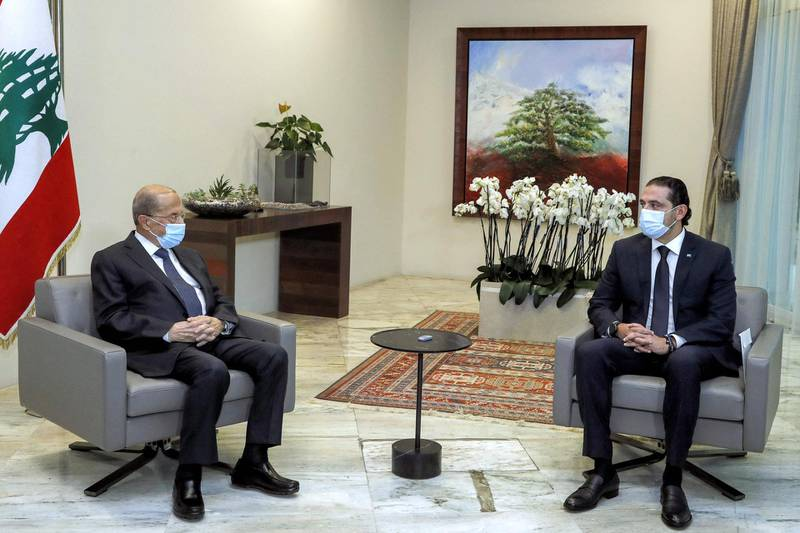 """A handout picture provided by the Lebanese photo agency Dalati and Nohra on March 22, 2021, shows Lebanese President Michel Aoun (L) meeting with prime minister-designate Saad Hariri at the presidential palace in Baabda, east of the capital Beirut. === RESTRICTED TO EDITORIAL USE - MANDATORY CREDIT """"AFP PHOTO / HO / DALATI AND NOHRA"""" - NO MARKETING - NO ADVERTISING CAMPAIGNS - DISTRIBUTED AS A SERVICE TO CLIENTS ===  / AFP / DALATI AND NOHRA / - / === RESTRICTED TO EDITORIAL USE - MANDATORY CREDIT """"AFP PHOTO / HO / DALATI AND NOHRA"""" - NO MARKETING - NO ADVERTISING CAMPAIGNS - DISTRIBUTED AS A SERVICE TO CLIENTS ==="""