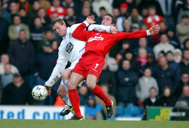 Leeds United's Steven Caldwell holds back Liverpool's Harry Kewell  (Photo by John Walton/EMPICS via Getty Images)