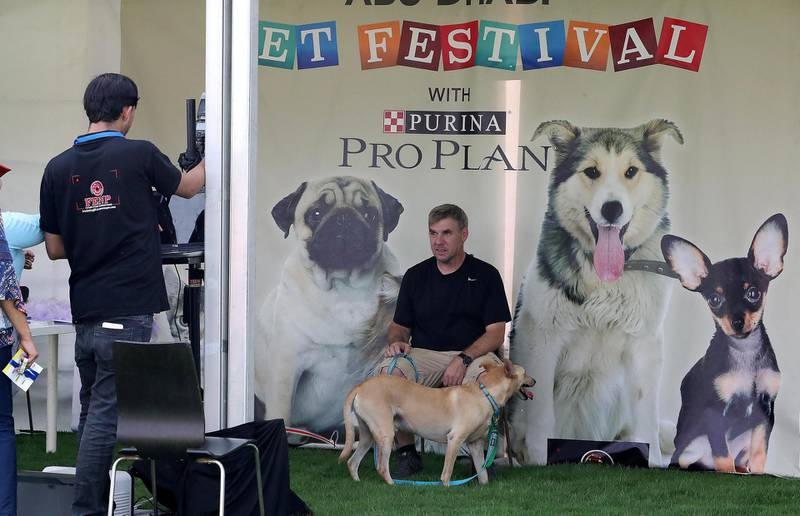 ABU DHABI , UNITED ARAB EMIRATES , APRIL 13   – 2018 :- People taking their photos with pets at the photo booth during the pet festival held at DU arena on Yas Island in Abu Dhabi. ( Pawan Singh / The National ) For News