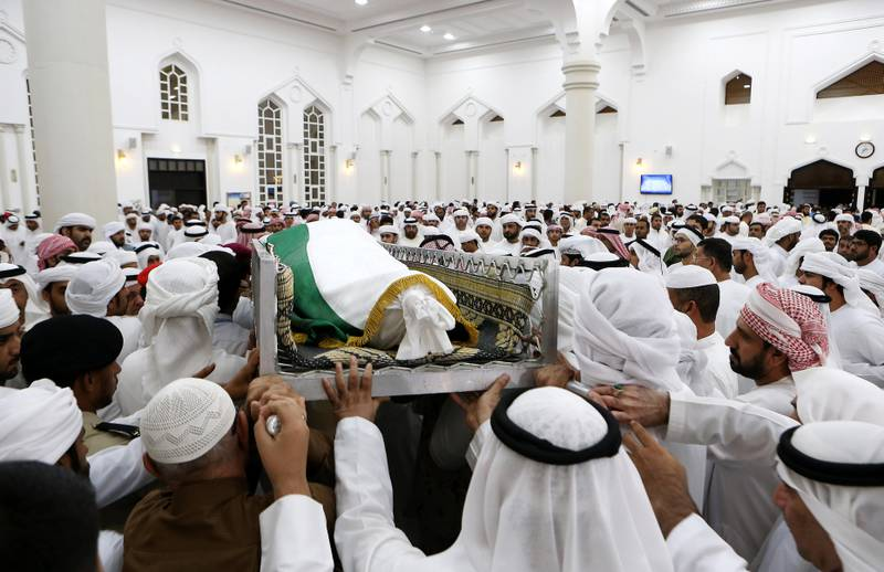 AJMAN , UNITED ARAB EMIRATES , AUG 12 – 2017 :- Family members and friends carrying the body of Sameer Mohammed Murad Abu Bakr , UAE solider who was killed in the helicopter crash in Yemen after the funeral prayers at the Sheikh Zayed Mosque in Ajman. ( Pawan Singh / The National ) Story by Nick Webster