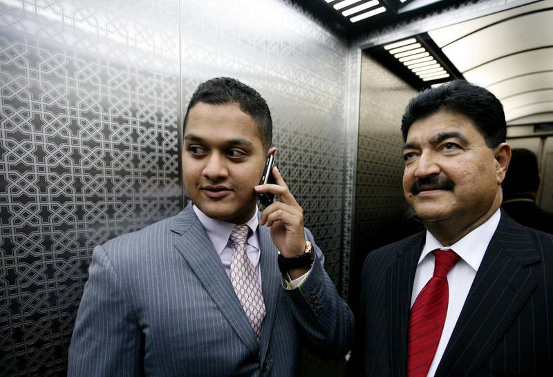 Abu Dhabi - July 2nd  ,  2008 - DR  B R Shetty and his son, Binay  (Grey Suit) at the NMC Hospital ,they  control one of Abu Dhabi's largest companies - the NMC group, which includes  the New Medical Centres, Neopharma - pharmacies and UAE Exchange. ( Andrew Parsons  /  The National ) *** Local Caption ***  ap005-0207-nmc shetty.jpgap005-0207-nmc shetty.jpg