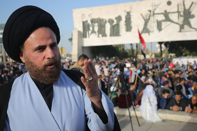 Ibrahim al-Jabiri, one of the leaders of Iraq's Shiite Sadr Movement, gives an interview during a demonstration by the movement in the capital Baghdad's Tahrir square against corruption in the Iraqi government on March 2, 2018. Followers of a black-turbaned Shiite cleric are seeing red ahead of Iraq's May elections, allying with the once-powerful communist party for the first time in the country's history.  / AFP PHOTO / AHMAD AL-RUBAYE
