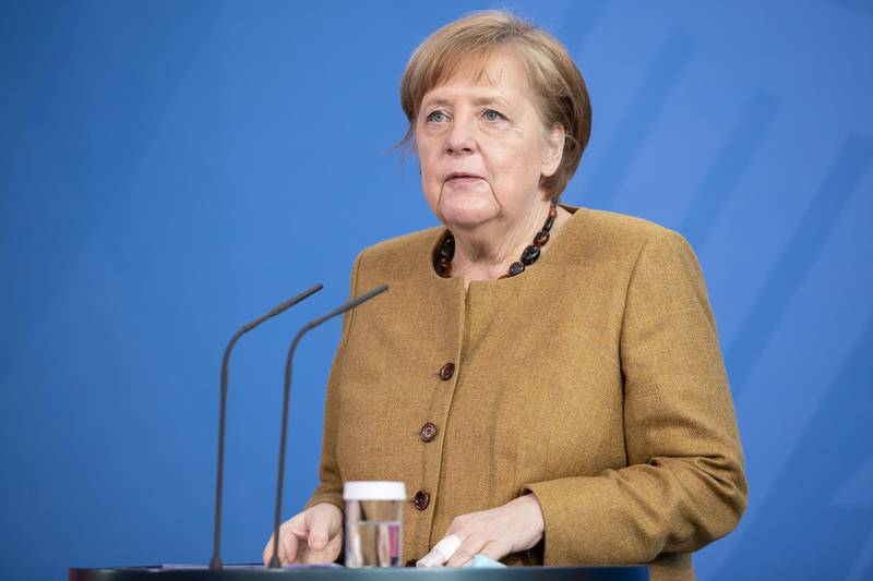 epa09132432 German Chancellor Angela Merkel gives a statement after a cabinet meeting in Berlin, 13 April 2021. The German cabinet in its 137th session agreed on a change of the German Infection Protection law amid the coronavirus pandemic that would allow the implementation of countrywide counter-measures in case of a certain rate of infections. Both chambers of the German parliament still have to approve the amendment.  EPA/ANDREAS GORA / POOL
