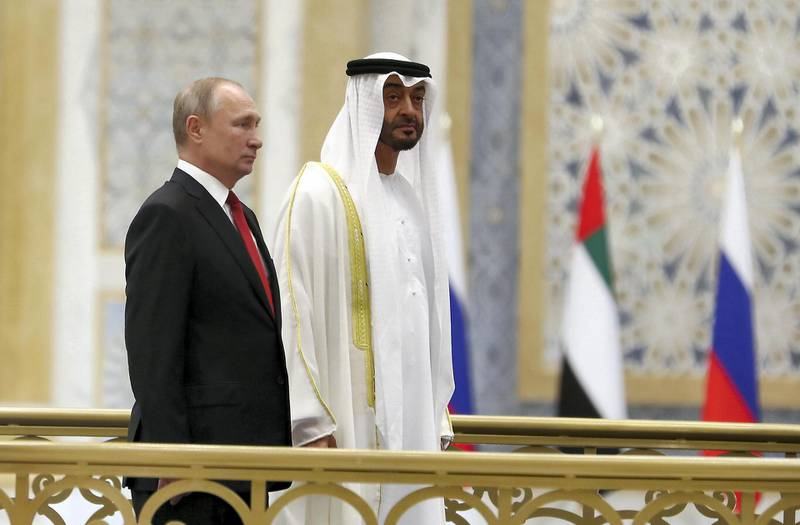 ABU DHABI , UNITED ARAB EMIRATES , October 15  – 2019 :- Sheikh Mohammed bin Zayed Al Nahyan, Crown Prince of Abu Dhabi and Vladimir Putin, President of Russia during the national anthem at the Presidential Palace in Abu Dhabi.  ( Pawan Singh / The National )  For News. Story by John