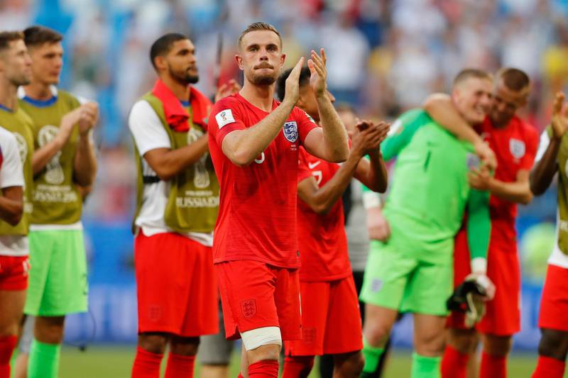 England's Jordan Henderson and his teammates celebrate victory of their team over Sweden during the quarterfinal match between Sweden and England at the 2018 soccer World Cup in the Samara Arena, in Samara, Russia, Saturday, July 7, 2018. (AP Photo/Frank Augstein)