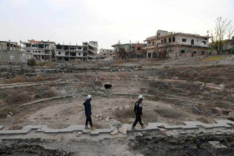 FILE PHOTO: Members of Syria Civil Defence, also known as the 'White Helmets', are seen inspecting the damage at a Roman ruin site in Daraa, Syria December 23, 2017. REUTERS/Alaa al-Faqir/File Photo