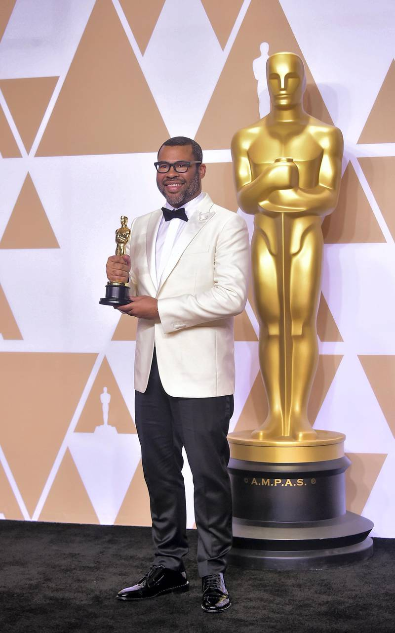 Director Jordan Peele poses in the press room with the Oscar for best original screenplay during the 90th Annual Academy Awards on March 4, 2018, in Hollywood, California. (Photo by FREDERIC J. BROWN / AFP)