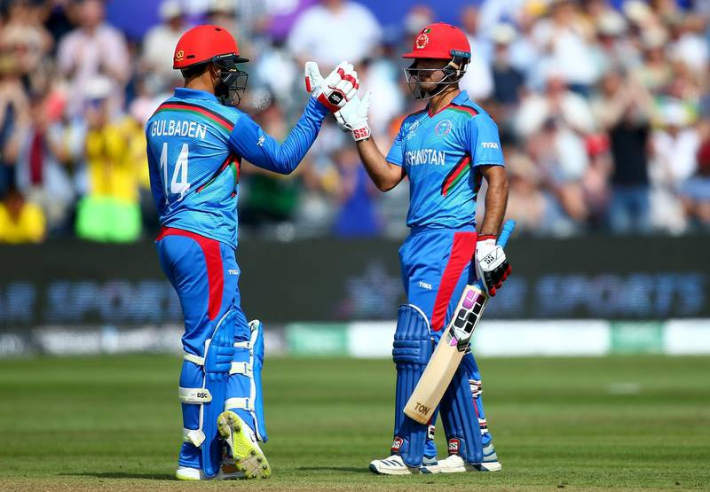 BRISTOL, ENGLAND - JUNE 01: Najibullah Zadran of Afghanistan celebrates his 50 with Gulbadin Naib of Afghanistan during the Group Stage match of the ICC Cricket World Cup 2019 between Afghanistan and Australia at Bristol County Ground on June 01, 2019 in Bristol, England. (Photo by Jordan Mansfield/Getty Images)