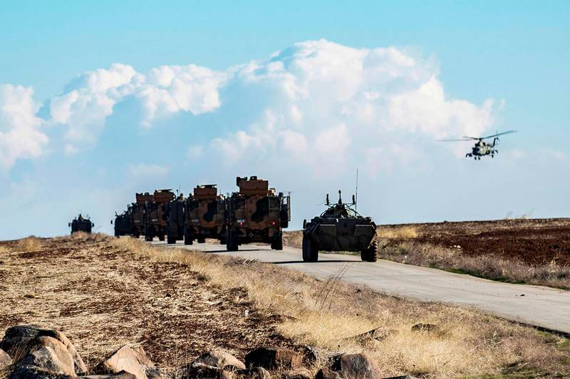 A joint Russian-Turkish patrol advances in the countryside of the Syrian town of al-Jawadiyah, in the northeastern Hasakeh province, near the border with Turkey, on December 24, 2020.  / AFP / Delil SOULEIMAN