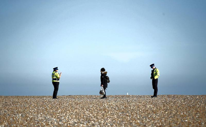 Police community support officers talk to a person as the spread of the coronavirus disease (COVID-19) continues, Brighton, Britain, April 4, 2020. REUTERS/Peter Cziborra