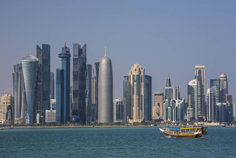 Middle East, Qatar, Doha City, View of West Bay Skyline with cityscape, boat floating on water in foreground (Photo by: JTB Photo/UIG via Getty Images) *** Local Caption ***  bz13ja-qatar-investments.jpg