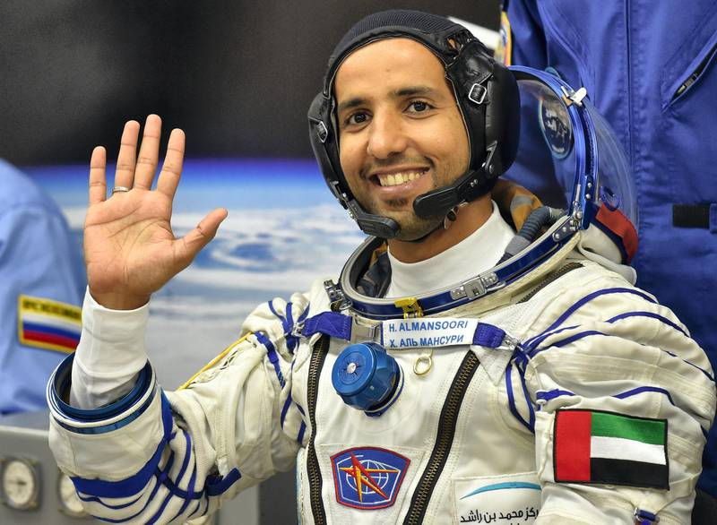 United Arab Emirates' astronaut Hazzaa al-Mansoori  waves before boarding a Soyuz rocket to the International Space Station (ISS) at the Russian-leased Baikonur cosmodrome in Kazakhstan on September 25, 2019. (Photo by VYACHESLAV OSELEDKO / AFP)