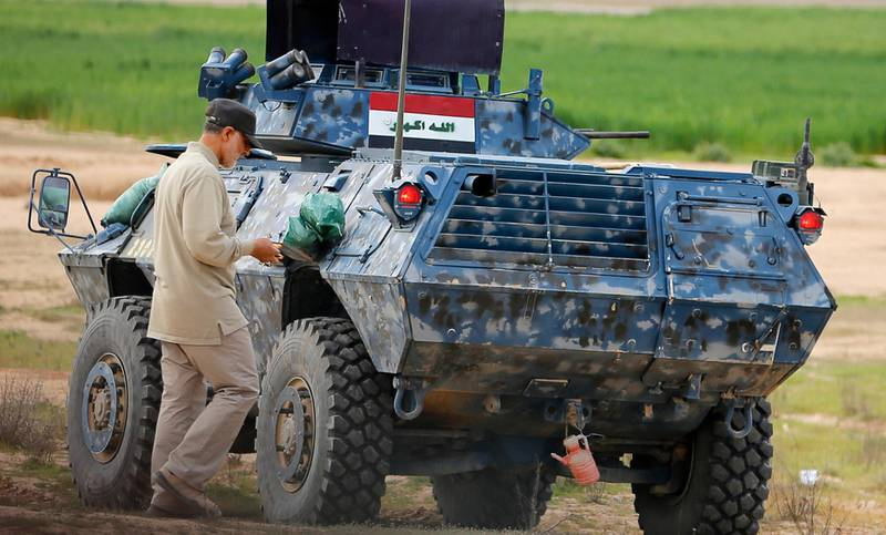 Iranian Revolutionary Guard Commander Qassem Soleimani walks near an armoured vehicle at the frontline during offensive operations against Islamic State militants in the town of Tal Ksaiba in Salahuddin province March 8, 2015. Picture taken March 8, 2015.   REUTERS/Stringer (IRAQ - Tags: CIVIL UNREST CONFLICT POLITICS)