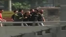 Watch people flee as gunfire breaks out in Beirut
