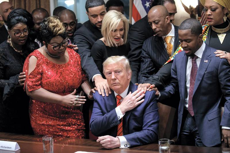 epa08939635 (FILE) US President Donald J. Trump (C) participates in a meeting with African American community, business and faith leaders in the Cabinet Room prior to the National African American History Month reception at the White House in Washington, DC, USA, 27 February 2020. The presidency of Donald Trump, which records two presidential impeachments, will end at noon on 20 January 2021.  EPA-EFE/SHAWN THEW *** Local Caption *** 56621651