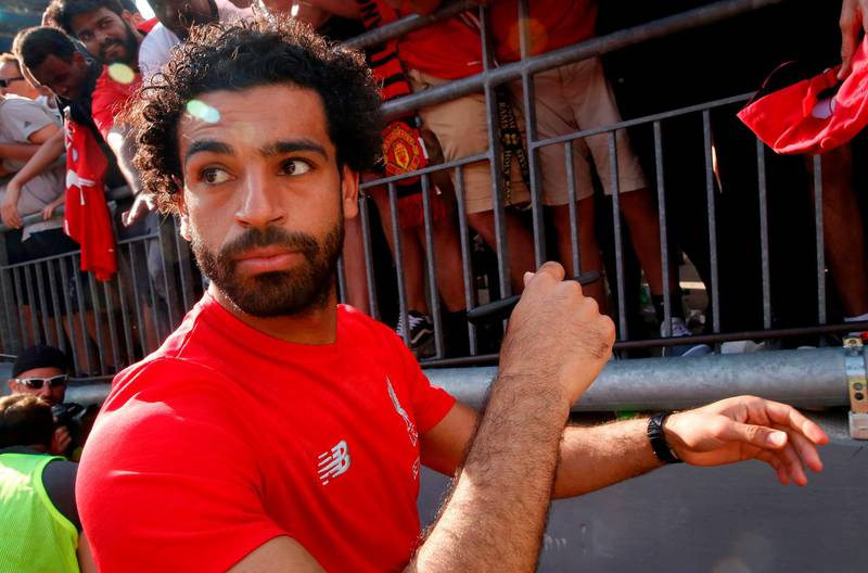 Mohamed Salah signs autographs after their game against Manchester United during their 2018 International Champions Cup match at Michigan Stadium in Ann Arbor, Michigan on July 28, 2018.  Liverpool FC beat Manchester United 4-1 in their friendly. / AFP / JEFF KOWALSKY