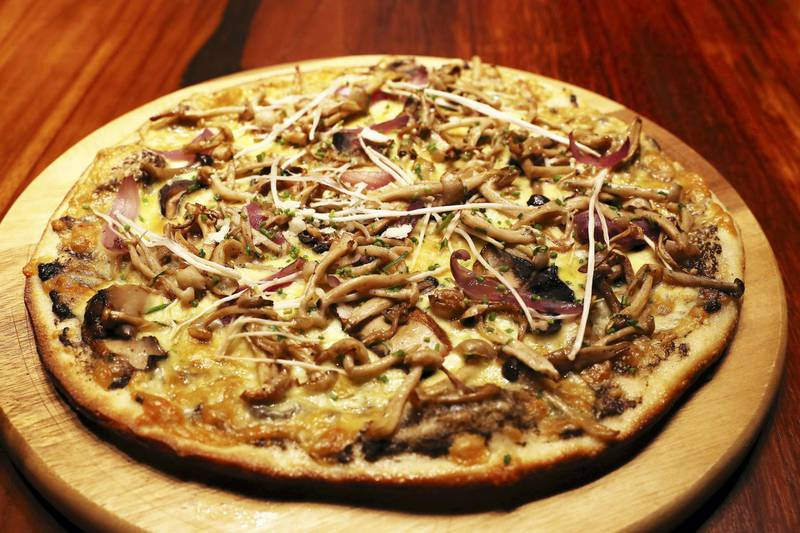DUBAI, UNITED ARAB EMIRATES , September 27 – 2020 :-  Vegan mushroom pizza at the Brass Monkey, new dining and entertainment destination on the Bluewaters Island in Dubai.  (Pawan Singh / The National) For Lifestyle/Online/Instagram. Story by Janice Rodrigues
