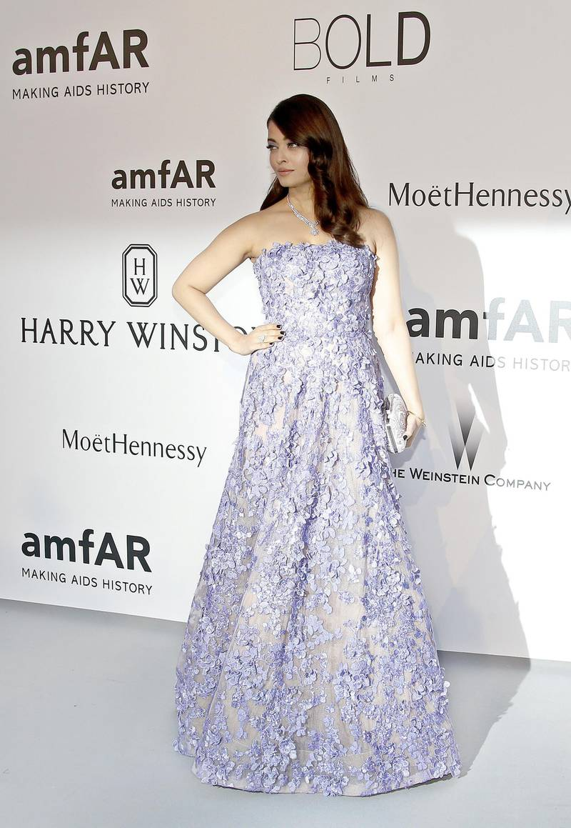 Indian actress Aishwarya Rai poses as she arrives for the amfAR 22st Annual Cinema Against AIDS during the 68th Cannes Film Festival at Hotel du Cap-Eden-Roc in Cap d'Antibes, southern France, on May 21, 2015. AFP PHOTO / VALERY HACHE (Photo by VALERY HACHE / AFP)
