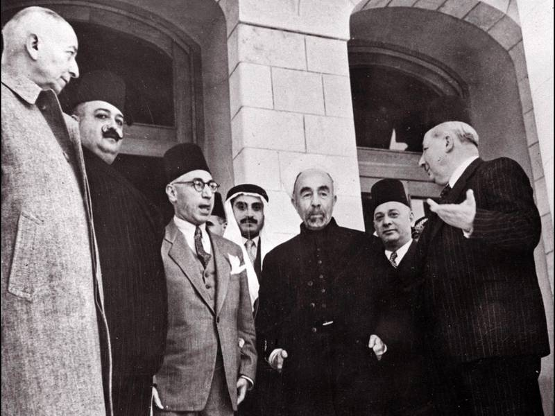 (FILES) King Abdullah I (C) of Transjordania (later Jordan) is surrounded by (L to R) an unidentified man, Lebanese defence minister Emir Megrid Arslan, Syrian Prime Minister Djamil Rey Mardam, an other unidetified man, and Lebanese Prime Minister Riad Bey Es-Solh during a meeting four days before the beginning of the first Arab-Israeli War in Amman on May 10, 1948. Jordan will mark 100 years of survival on April 11 as a resource-poor country in a war-ravaged neighbourhood, but the worst palace crisis in decades and the coronavirus pandemic threaten to overshadow any celebrations. / AFP / AFP FILES / -