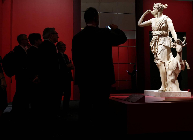 Visitors look at the marble statue of Diana of Versailles at the Louvre Abu Dhabi in Abu Dhabi, UAE, December 19, 2017. REUTERS/Satish Kumar