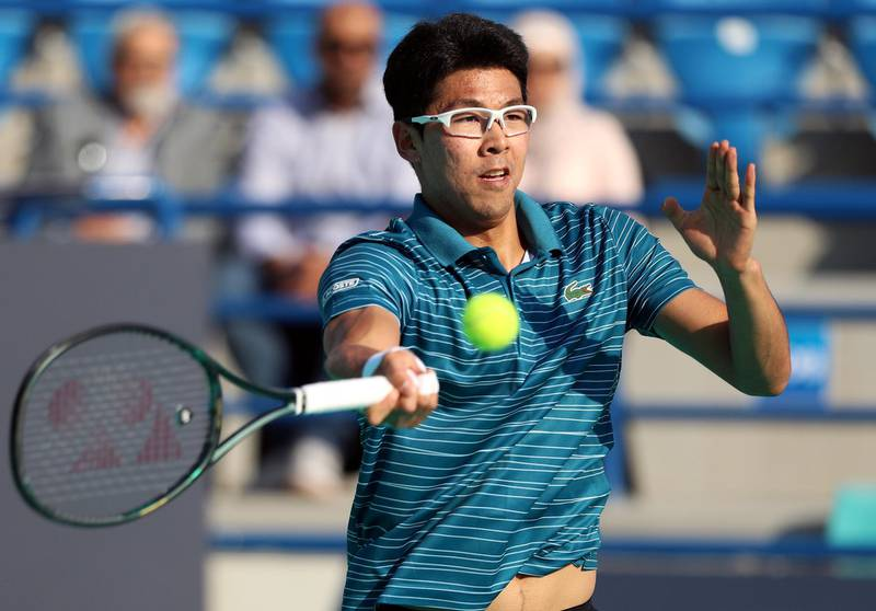 Abu Dhabi, United Arab Emirates - Reporter: Jon Turner: Hyeon Chung hits a shot during the fifth place play-off between Andrey Rublev v Hyeon Chung at the Mubadala World Tennis Championship. Friday, December 20th, 2019. Zayed Sports City, Abu Dhabi. Chris Whiteoak / The National