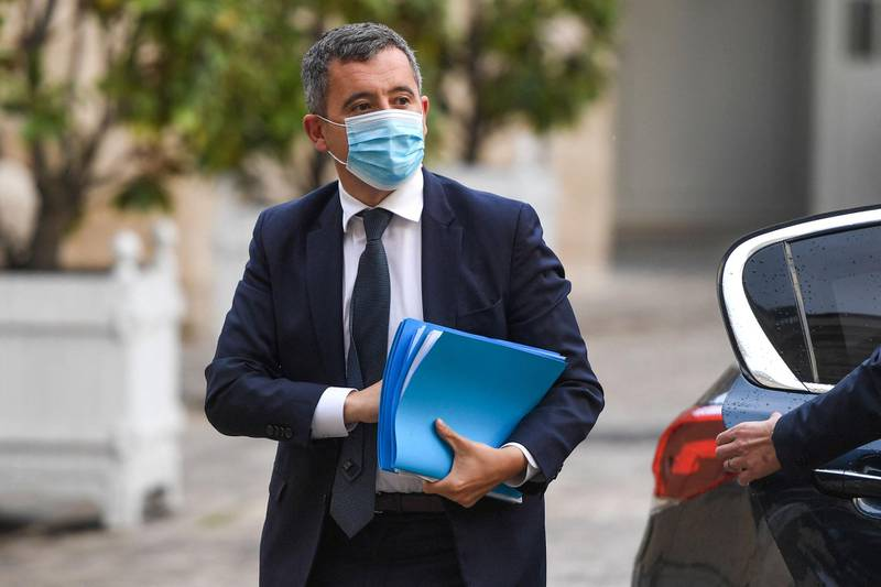 """CORRECTION / French Interior Minister Gerald Darmanin arrives at a meeting with French police unions at the Hotel Matignon in Paris on May 10, 2021. After the deaths of a police employee killed in a terror attack at the police station in Rambouillet on April 30, 2021, and a police officer killed in Avignon on May 5, 2021 during an anti-drug operation, French police unions call for a """"citizens' march"""" in Paris on May 19, 2021. / AFP / Christophe ARCHAMBAULT"""
