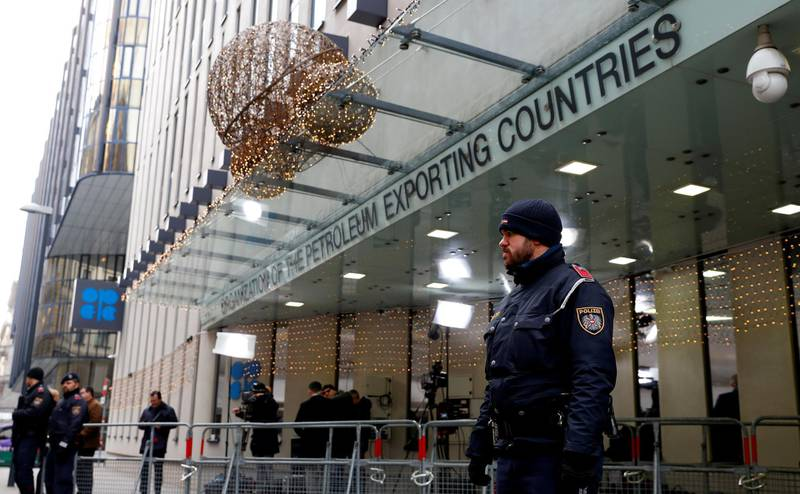 FILE PHOTO: Journalists and police officers stand outside the headquarters of the Organization of the Petroleum Exporting Countries (OPEC) in Vienna, Austria, December 5, 2019.  REUTERS/Leonhard Foeger/File Photo