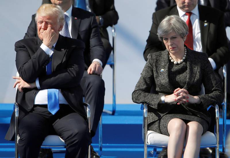FILE PHOTO: U.S. President Donald Trump and Britain's Prime Minister Theresa May react during a ceremony at the new NATO headquarters before the start of a summit in Brussels, Belgium, May 25, 2017.    REUTERS/Christian Hartmann/File Photo
